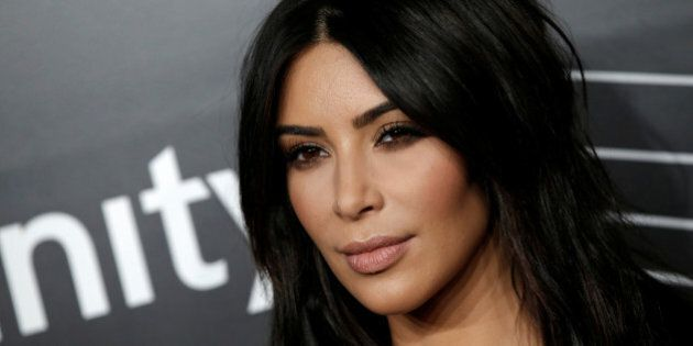 Kim Kardashian West poses as she arrives for the 20th Annual Webby Awards in Manhattan, New York, U.S.,...