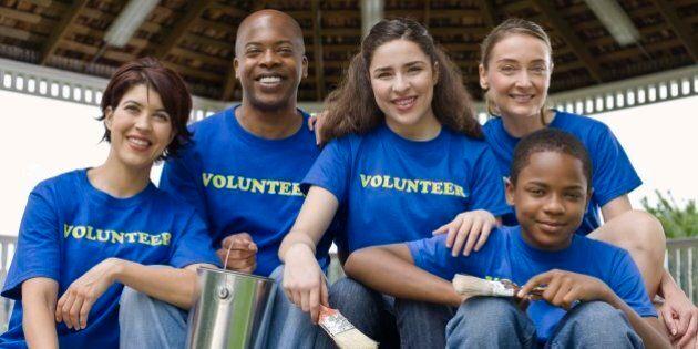 Portrait of volunteers holding painting