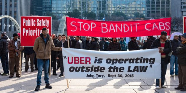 TORONTO, ONTARIO, CANADA - 2015/12/09: Toronto taxi drivers protest against the operation of UberX who was deemed illegal by the city until new regulation bylaws are approved. UberX is giving unfair competition to the taxi industy. (Photo by Roberto Machado Noa/LightRocket via Getty Images)
