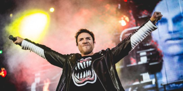 British singer Simon Le Bon (Simon John Charles Le Bon) in concert with Duran Duran. On the screen behind him there is the realistic robotic face of one of the characters of the music video The Wild Boys. Paper Gods Tour, Assago Summer Arena. Milan (Italy), 12th June 2016 (Photo by Francesco Castaldo/Archivio Francesco Castaldo/Mondadori Portfolio via Getty Images)