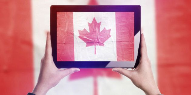 Person Taking Picture of Canada Flag with Digital Tablet Computer, Vintage Tone Retro