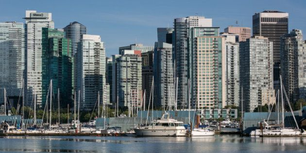 VANCOUVER, CANADA - JUNE 30: The city skyline and Coal Harbour are viewed from Stanley Park on June 30,...
