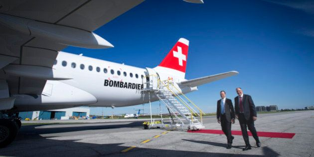 Rob Dewar, vice president of CSeries program for Bombardier Aerospace, right, and Fred Cromer, president...