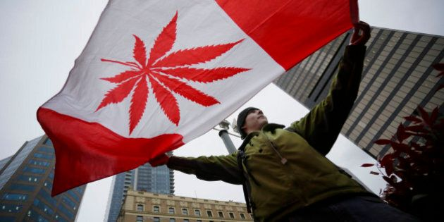 [UNVERIFIED CONTENT] A pot supporter holds up a flag to celebrate the International Cannabis Day in Downtown...