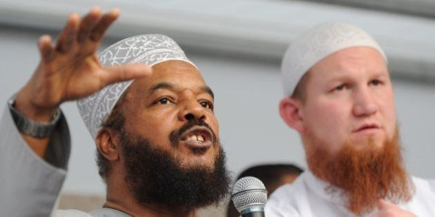 Controversial German Islamist preacher Pierre Vogel (R) and Abu Ameenah Bilal Philips, an Islamic scholar...