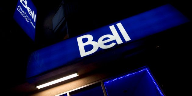 Signage is displayed outside of a BCE Inc. Bell Canada store in Toronto, Ontario, Canada, on Wednesday,...