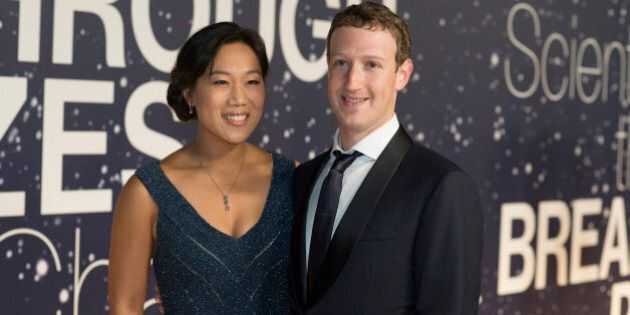 Priscilla Chan and Mark Zuckerberg arrive at the 2nd Annual Breakthrough Prize Award Ceremony at the NASA Ames Research Center on Sunday, Nov. 9, 2014 in Mountain View, California. (Photo by [Peter Barreras]/Invision/AP)