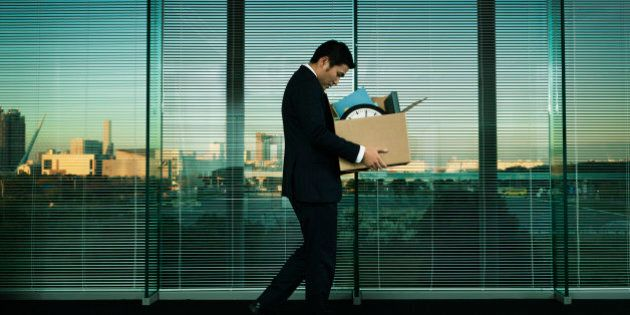 Subject: A Japanese business office worker leaving his job with all his belonging in a layoff and economic