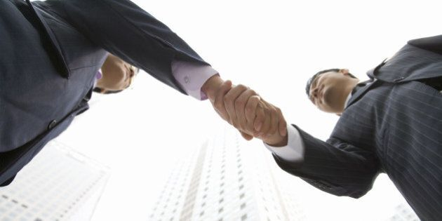 Two Businessmen Shaking Hands, China,