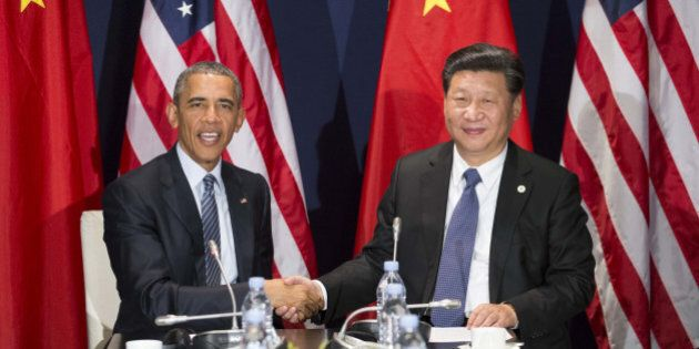 PARIS, Nov. 30, 2015 -- Chinese President Xi Jinping, right, meets with his U.S. counterpart Barack Obama...