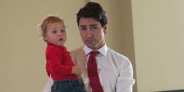 Canadian Liberal Party leader Justin Trudeau waits with his son Hadrien to cast his ballot in Montreal on October 19, 2015.The first of 65,000 polling stations opened Monday on Canada's Atlantic seaboard for legislative elections that pitted Prime Minister Stephen's Tories against liberal and social democratic parties. Up to 26.4 million electors are expected to vote in 338 electoral districts. Some 3.6 million already cast a ballot in advance voting a week ago, and the turnout Monday is expected to be high.   AFP PHOTO/NICHOLAS KAMM        (Photo credit should read NICHOLAS KAMM/AFP/Getty Images)