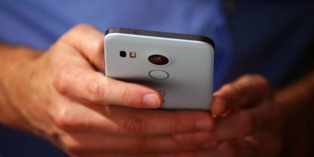 SAN FRANCISCO, CA - SEPTEMBER 29: An attendee inspects the new Nexus 5X phone during a Google media event...
