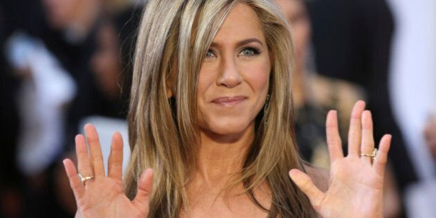 Actress Jennifer Aniston wears a Versace dress and Fred Leighton jewelry as she arrives at the 87th Academy...