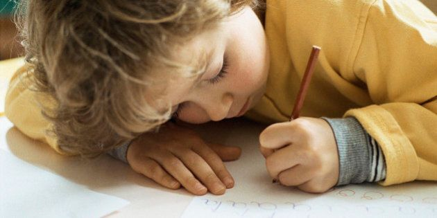 Little girl writing at