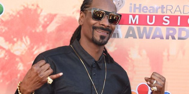 LOS ANGELES, CA - MARCH 29: Snoop Dogg arrives at the 2015 iHeartRadio Music Awards at The Shrine Auditorium...