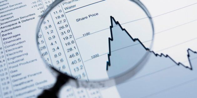 Magnifying glass and descending line graph and list of share