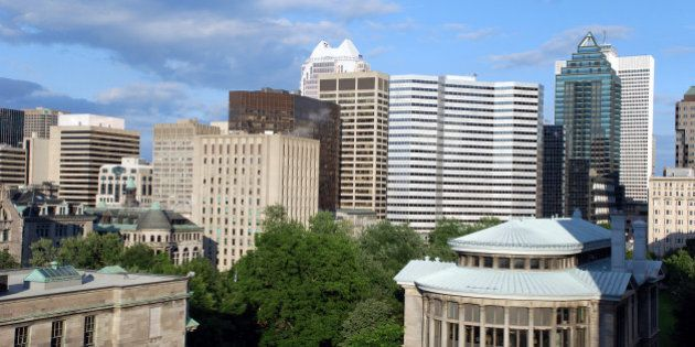'McGill University's leafy campus is in the foreground, and downtown office buildings in the background.'