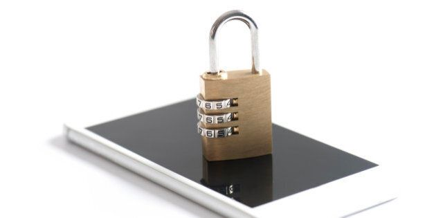 Gold padlock on the white smart phone. Security
