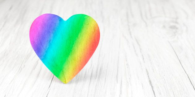 Rainbow colors heart on white background, space for