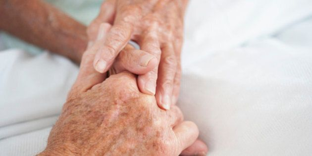 Husband comforting wife in hospital