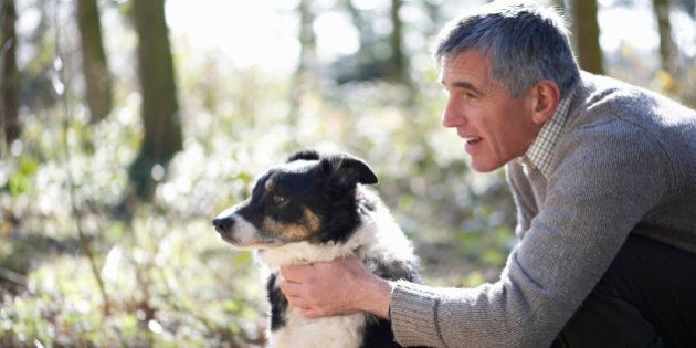 Man with dog in countryside