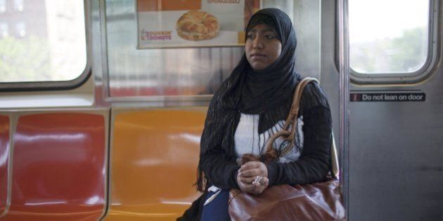 QUEENS, NY - MAY 11: High school senior Sharmin Hossain rides the subway May 11, 2010 on her way to school...