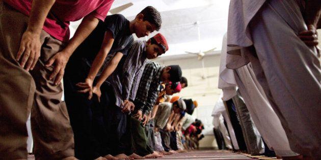 CHENAB NAGAR, PAKISTAN - JULY 14: Members of the persecuted Ahmadiyya community pray in a mosque on July...