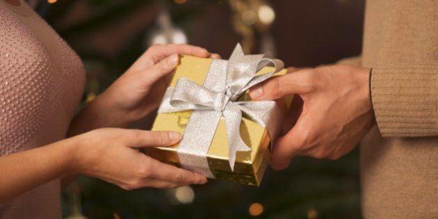Woman giving man Christmas