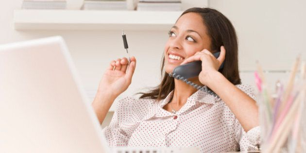 Businesswoman on telephone in