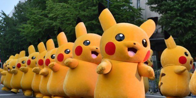 Costumed performers as Pikachu, the popular animation Pokemon series character, perform at the Yokohama...