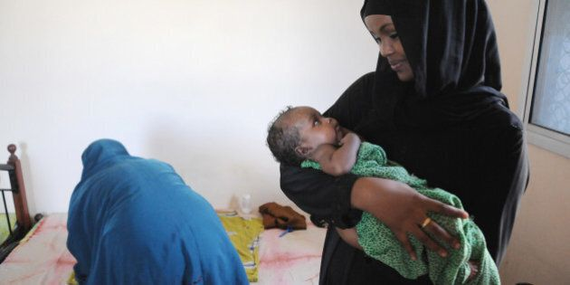 MOGADISHU, SO - MAY 4: Canadian Ilwad Elman holds a month-old-baby in the Elman Peace Center, a rape...