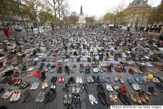 Thousands Leave Shoes In Paris To Replace Banned Climate
