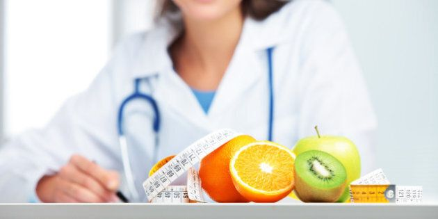 Nutritionist female Doctor in her office. Focus on