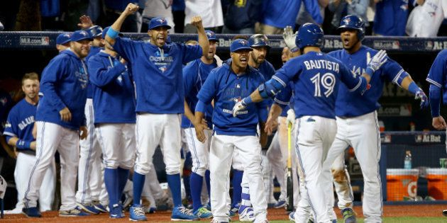 TORONTO, ON - OCTOBER 14: Jose Bautista #19 of the Toronto Blue Jays celebrates his three-run home run...