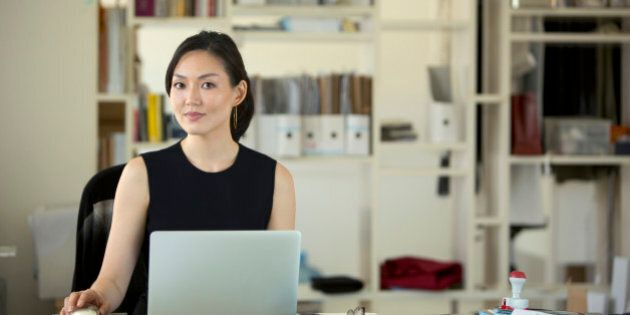Asian Businesswoman on laptop computer in