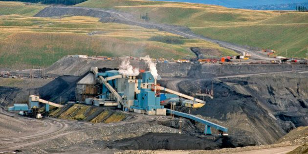 A coal processing plant in the Alberta Rocky Mountain Foothills with reclaimed area in the background....