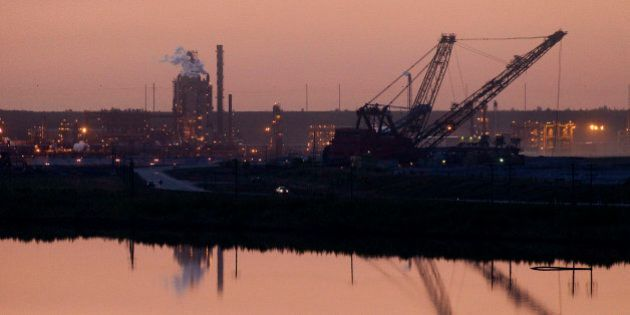 The Syncrude Canada Ltd. upgrader plant of the company's mine stands at dusk in the Athabasca Oil Sands...