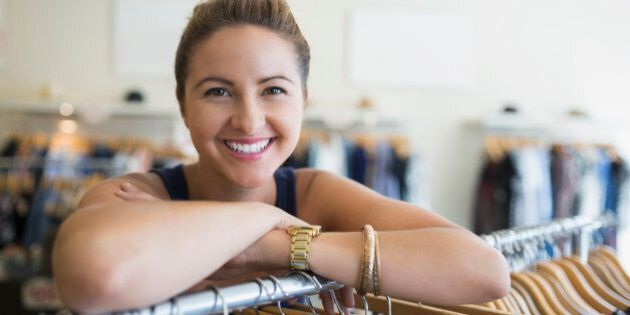 Portrait smiling woman in clothing shop