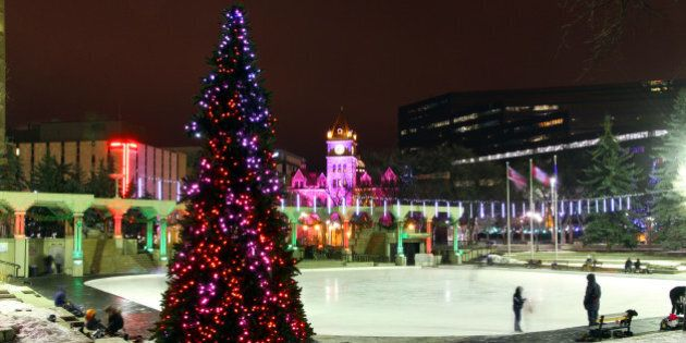 Downtown Calgary's Olympic Plaza glowing on a cold winter night.