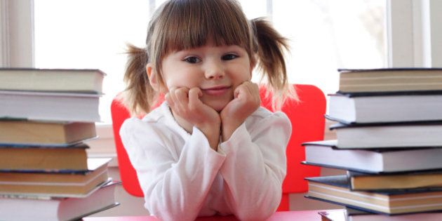 Little  girl and books for reading