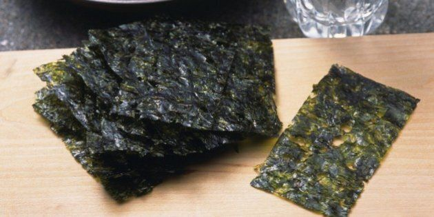 Image of Some Dried Seaweed on a Wooden Surface and Some Sake, High Angle View