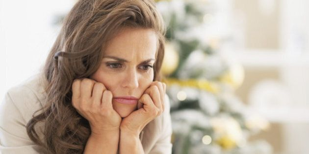 Portrait of frustrated young woman near christmas