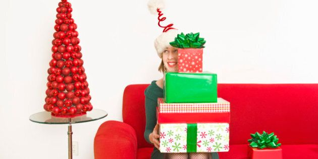 Woman holding stack of Christmas