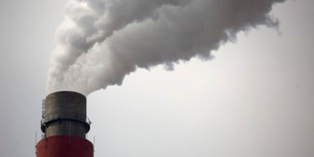 In this Nov. 3, 2015 photo, smoke and steam rise from the smokestack of a coal-fired power plant near Ordos in northern China's Inner Mongolia Autonomous Region. China's polluted air is still largely hazardous to health, and officials won't even guess when air will finally reach levels that could be considered healthy. But some experts, officials and observers see this year's improvement as the start of a long-term upward trend in air quality resulting from central and local government measures to lower pollution. (AP Photo/Mark Schiefelbein)