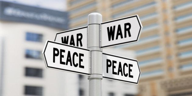 Street signs showing war and peace