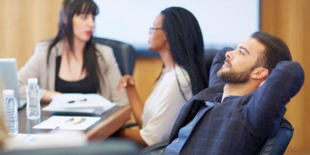 Businessman leaning back in boardroom