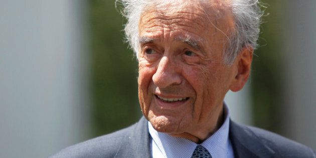 Writer, Nobel Laureate and holocaust survivor Elie Wiesel speaks to the media outside the West Wing of...