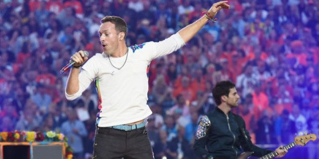 SANTA CLARA, CA - FEBRUARY 07: Chris Martin of Coldplay performs onstage during the Pepsi Super Bowl 50 Halftime Show at Levi's Stadium on February 7, 2016 in Santa Clara, California. (Photo by Jeff Kravitz/FilmMagic)