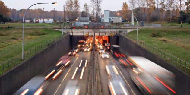 'Blurred headlights traveling under the Massey Tunnel outside Vancouver, British Columbia'