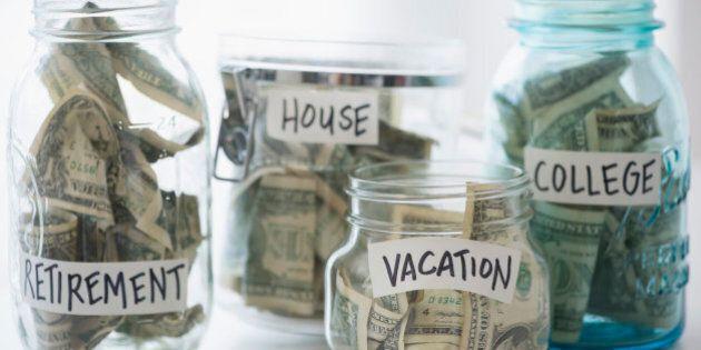 Close up of savings jars with money